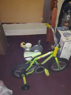 Little boys riding bike with training wheels