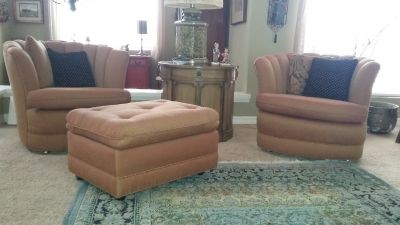 Two chairs including two ottomans.