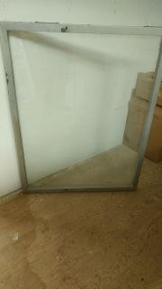 Plate glass in heavy metal frame