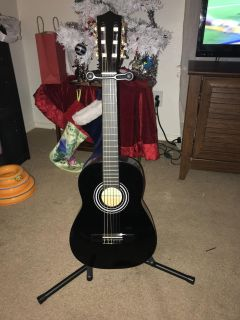 3/4 guitar with stand, book, picks and case