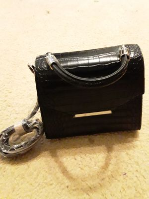 Brand new black small purse (see both pictures)