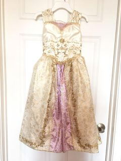 Disney Store Rapunzel s wedding gown. Girls size 8. Excellent used condition. From a smoke free home.