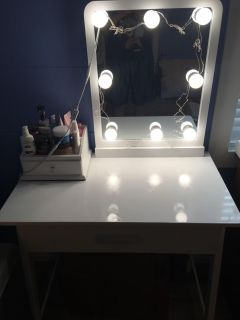 Vanity with attached daylight lights