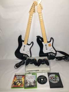 Xbox 360 bundle with 2 controllers 2 guitars cables and 5 games