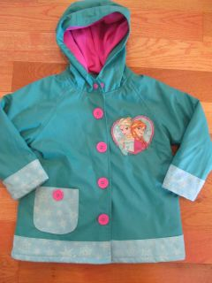 Frozen Raincoat (heavy lined) size 3T (a small light spot on front, small section of stitching coming undone on hood)