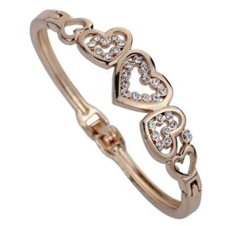 Bracelet with Beautifully Carved Out Hearts with Surrounding CZ Accents