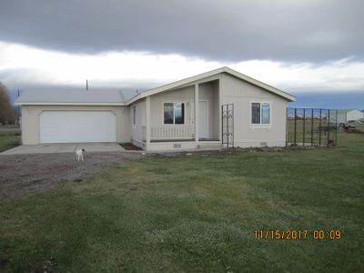 3 bed 2 bath Manufactured Home with 2 car attached garage on 3 Acres