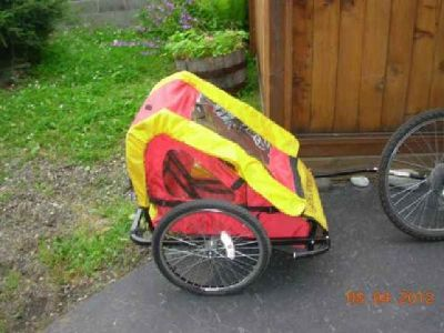 $80 Cycle Pro Yellow and red Child x2 BikeTrailer (Near Elmore & 68th)