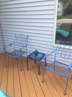 Patio or deck wrought iron table and chairs.