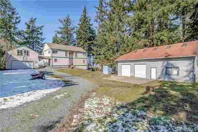 18210 CLARENCE Ave Stanwood Four BR, WATERFRONT estate on 1.35