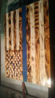 Handcrafted American flag wall hanging.