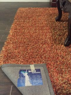 Shag rug with vibrant shades of rust