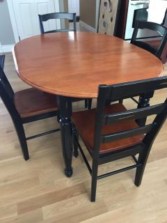 Distressed Black and Cherry wood table and chairs