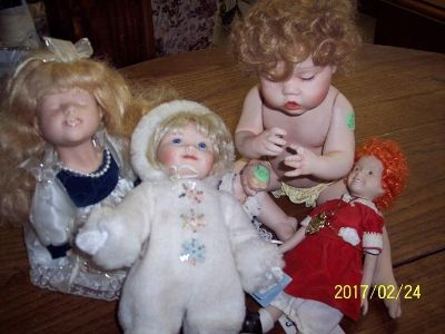 Variety of Collectible Porcelion Dolls