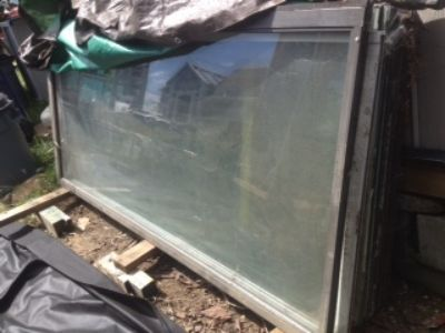10 LARGE GLASS PANELS, PATIO DOORS AND 2 WINDOWS