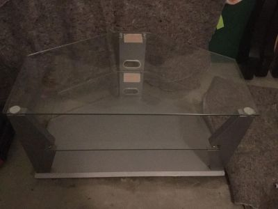 Tv stand, silver with HEAVY, solid glass shelves. In GUC except some cosmetic wear on bottom edges. , scroll right to see $7.00