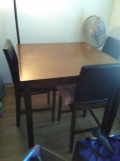 Dining room table with 4 chairs and stand fan