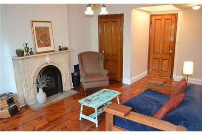 1 bedroom Apartment - The entrances opens into a living room with hard wood floor.