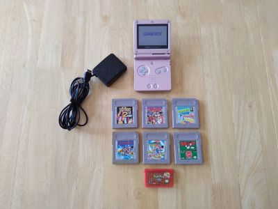Nintendo Gameboy advance SP Pearl pink with charger and 7 games including Pokemon