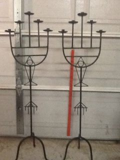 Ornate antique wrought iron candelabras