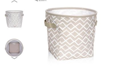 New in pkg THIRTY ONE mini storage bin , holds up to 6 rolls of toilet paper so not really mini!! Polyester /canvas like