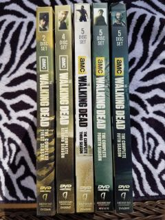 The Walking Dead seasons one through five DVDs with bonus scenes, commentary, and behind the scenes footage