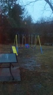 Swing set. $100 new. Bought for daycare this summer. Great condition. Pads on legs. Safety.