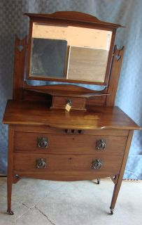 Charming vanity style dresser with mirror