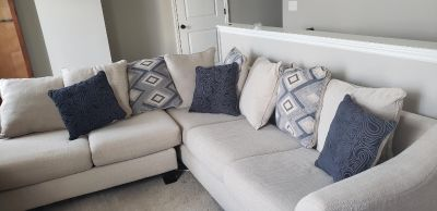 Sectional couch with ottom