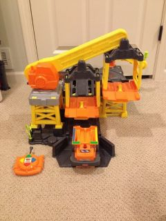 Remote control dump truck and construction site