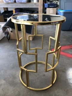 Cute little table. 13 inches round. 20 inches tall. Mirror on top