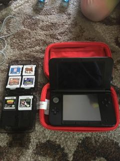 3DS XL with 10 games and charger and game cases