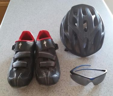 Cycling shoes, helmet and sunglasses.