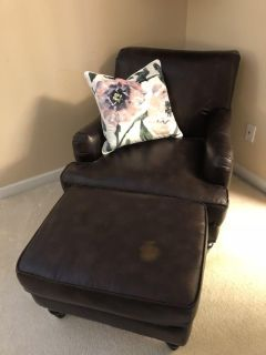 Cute brown faux leather chair and ottoman