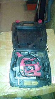 red and gray skil saw
