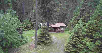 Huning/Recreational Cabin with creek. Property has several o