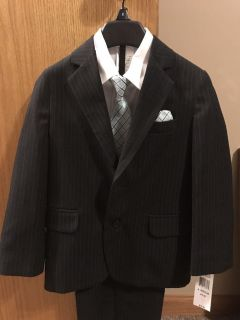Boys size 6 pin striped 4 piece suit. Asking $20