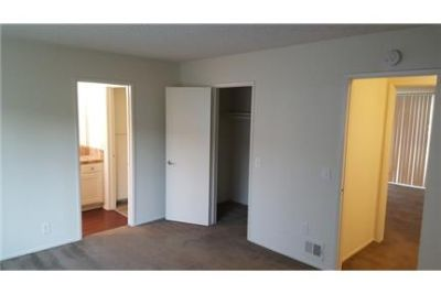 SPACIOUS 2/1. 5 TOWNHOUSE STYLE UNIT WITH CARPORT PARKING