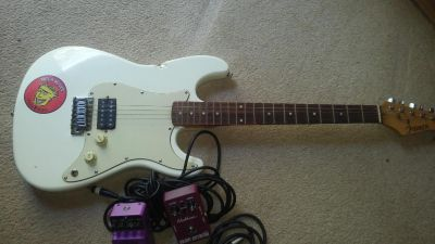 Guitar, two pedals and two cables
