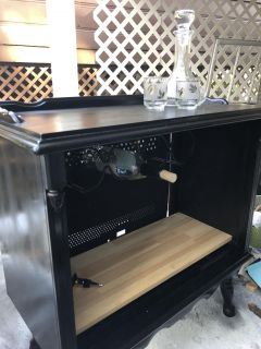 Cabinet. Cute painted cabinet with wine rack