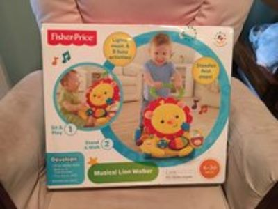 NIB Fisher Price Musical Lion Walker