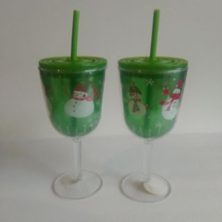 Two plastic snowman wine glasses with straws & lids