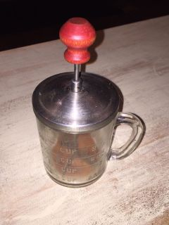 Vintage glass measuring cup with nut /onion chopper