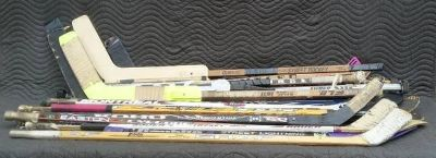 Large Lot of Hockey Sticks