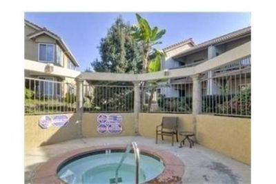Great corner location with private patio double door entry. Single Car Garage!