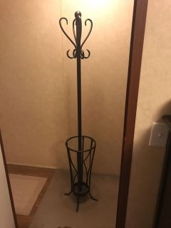 Coat rack umbrella stand. Has a few scratches. Top can unscrew for transport.