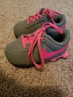 Pink and gray Nike toddler size 4c