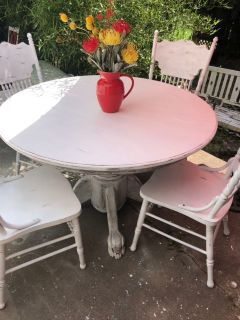 Table and 4 chairs. White distressed solid wood