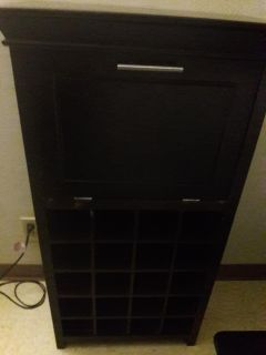 Wine bottle storage with top cabinet