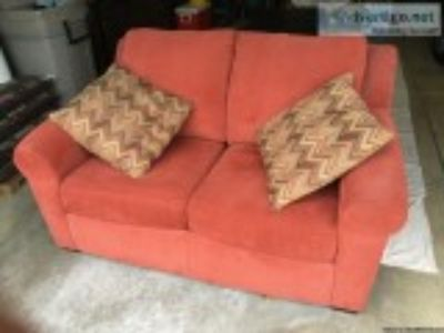 Loveseat with coordinating throw pillows